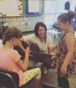 Music therapist Lindsey Perrault works with children with special needs at Pine Grove Learning Center. (June 2, 2016)
